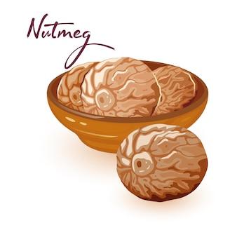 Семена коричневого мускатного ореха с чуть более сладким вкусом находятся в керамической миске.