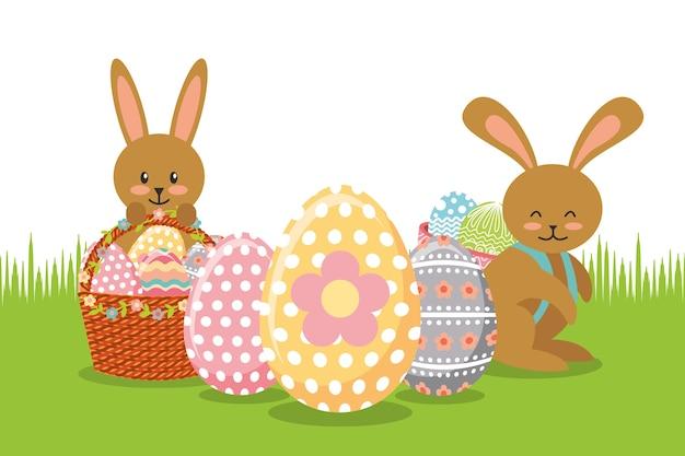 Браун-кролики с корзинами и украшением яиц на лугу
