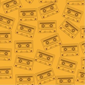 黄色の背景ベクトル上に茶色のシルエットカセット