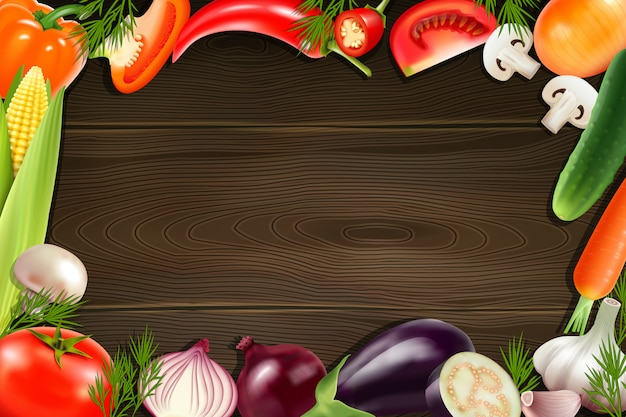Brown wooden background with frame composed from colorful whole and sliced vegetables