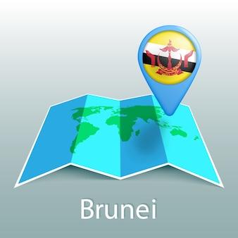 灰色の背景に国の名前とピンでブルネイの旗の世界地図