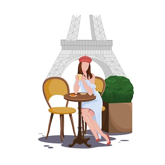 파리의 거리 카페에서 갈색 머리 소녀