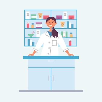 Brunette girl pharmacist behind the counter