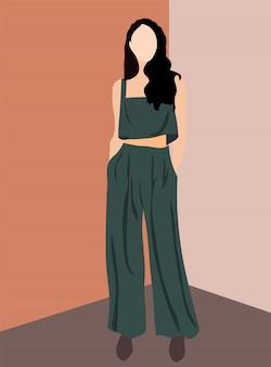 オリーブパンツ、トップと茶色の靴に身を包んだブルネットの魅力的な女性