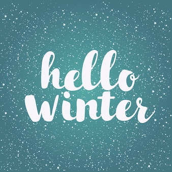 Brush lettering at winter background with snowflakes