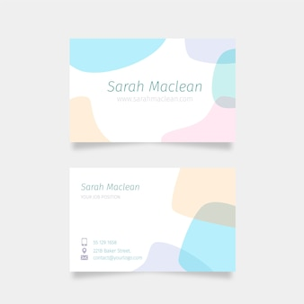 Brush strokes in gentle pastel colours and stains business card