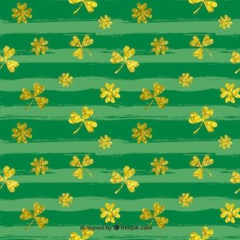 Brushstroke pattern with golden clovers