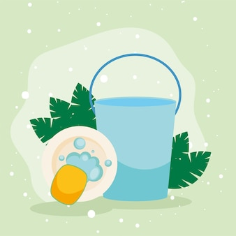 Bucket and sponge washing plate on green background