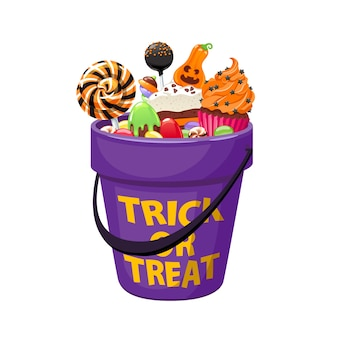 ハロウィンのお菓子やキャンディーとバケツ