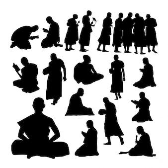 Buddhist monk gesture silhouettes.