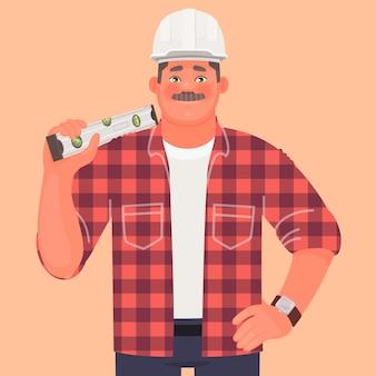 Строитель. мужчина в каске и спецодежде держит строительный уровень. прораб на стройке.