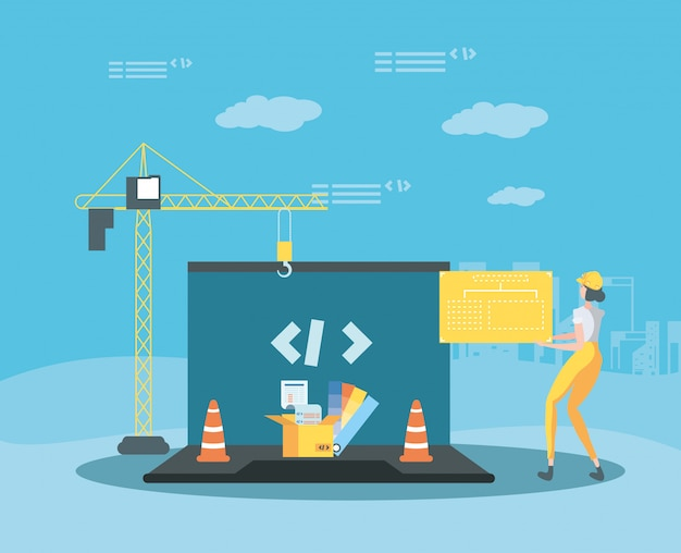 Builder and laptop with webpage under construction