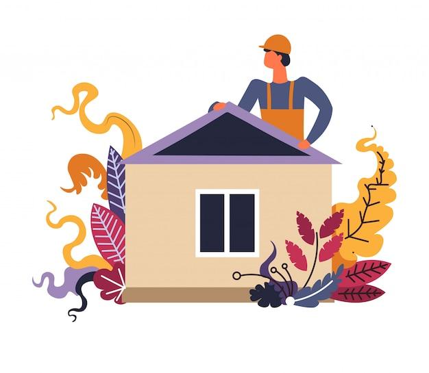 Строитель человек заканчивает процесс строительства дома