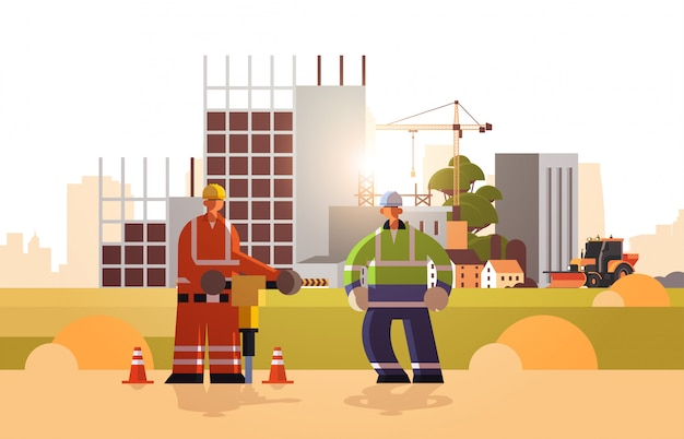 Builders couple drilling with jackhammer wearing hard hat busy workmen working together industrial workers in uniform building concept construction site background horizontal flat full length