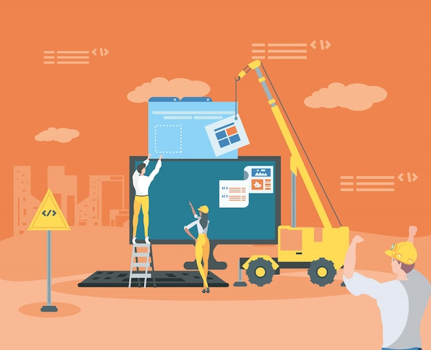Builders and desktop with webpage under construction