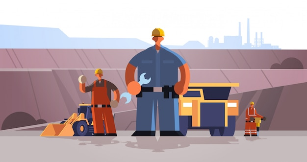 Builders workmen using wrench and jackhammer industrial construction workers in uniform near mining transport building coal mine production concept opencast stone quarry background full length