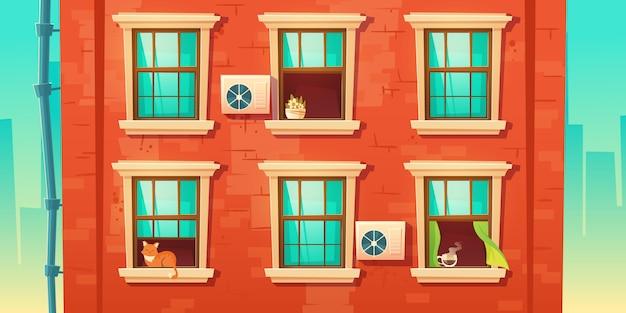 벽돌 벽과 창문이 건물 외관