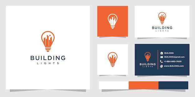 Дизайн логотипа здания с огнями и визитной карточкой.