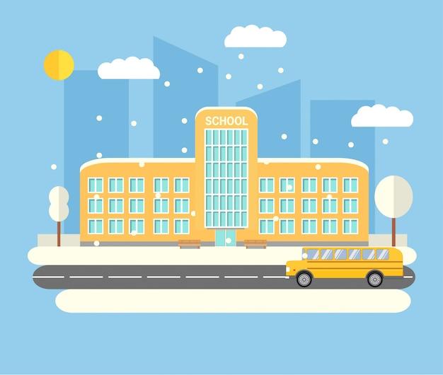 Здание городского старшего школьного образования. желтый школьный автобус. зимнее время городской пейзаж небоскребов падает снег.