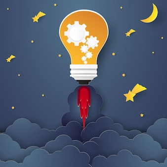 Bulb rocket flying above at night for idea concept in paper art style