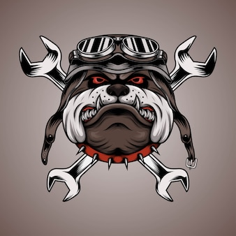 Bulldog head wearing motorcycle helmet with wrench