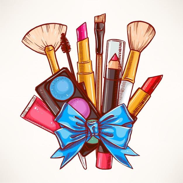 Связка декоративной косметики, перевязанная голубой лентой