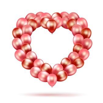 Букет-пачка в виде сердца из розовых и красных воздушных шаров.