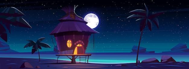 열대 섬에 밤에 방갈로