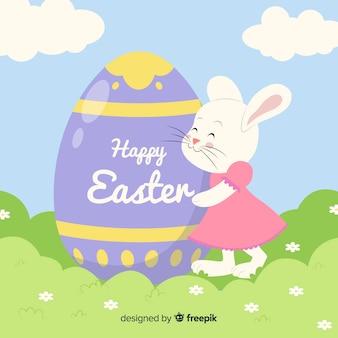 Bunny hugging an egg easter background