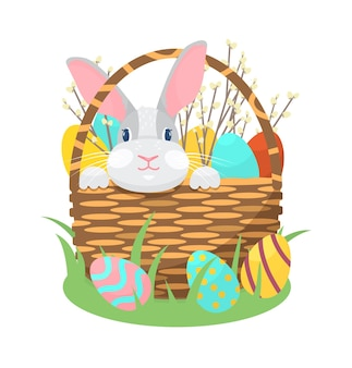 Premium Vector | Bunny sitting in a basket with easter eggs and willow  branches