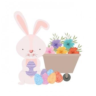 Bunny with wheelbarrow and easter eggs icon