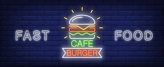 Burger cafe neon sign. Glowing tasty big burger on dark brick wall.