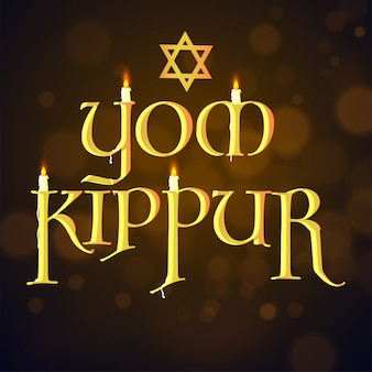 Burning candles in glossy golden yom kippur text