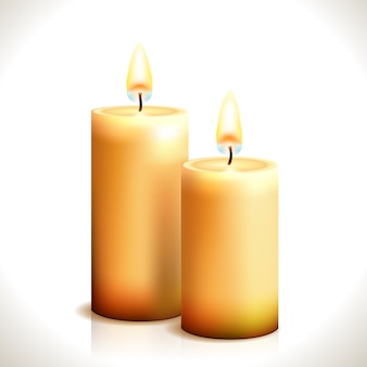 Burning candles isolated
