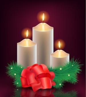クリスマスツリーと赤い蝶ネクタイでキャンドルを燃やす