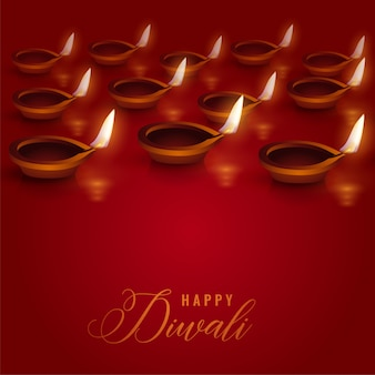 Burning diya lamps placed on red background