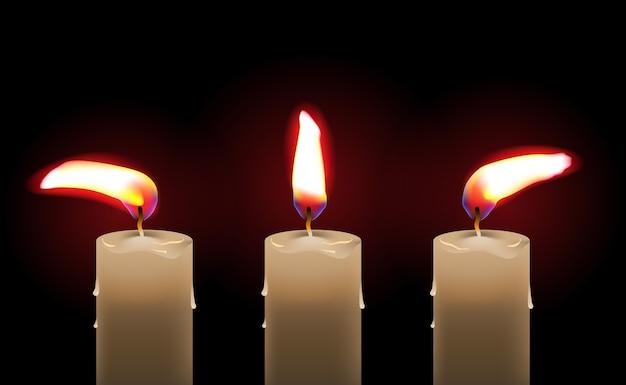 Горящая восковая свеча на черном
