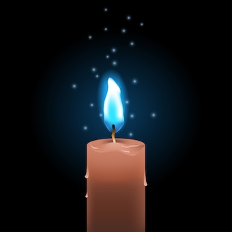 Burning wax candle with blue fire