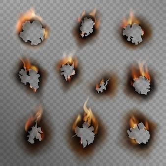 焦げた穴。焦げた紙の穴、茶色の縁を炎で燃やしました。ひびの入った汚れた穴での火災、現実的なセット