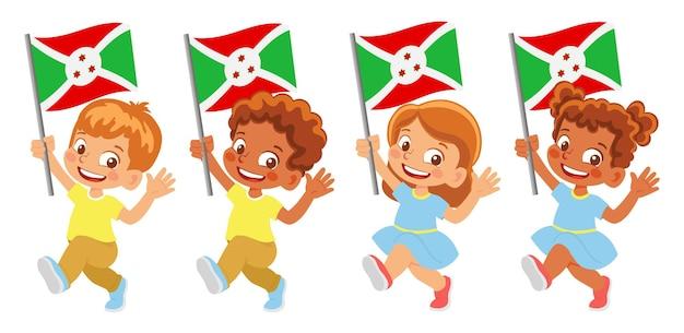 Флаг бурунди в руке. дети держат флаг. государственный флаг бурунди