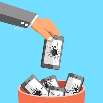 Business big hand throwing broken smartphone to trash bin