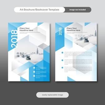 市の背景と幾何学的形状を備えたビジネスパンフレット、チラシ、ブックカバーデザイン