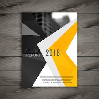 Business brochure with yellow abstract geometric shapes