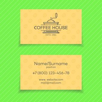 Business card of coffee house with logo coffee machine.