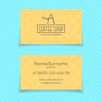 Business card of coffee shop isolated on turquoise