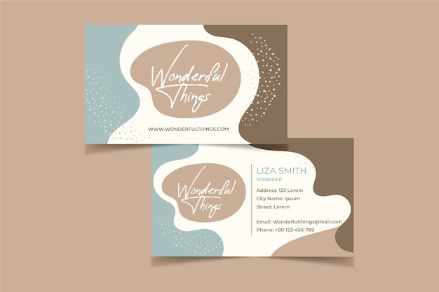 Business card concept with pastel-colored stains