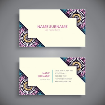 Business card decorated with colorful mandalas
