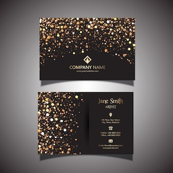 Business card decorated with golden dots