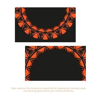 Дизайн визитной карточки в черном цвете с оранжевым орнаментом. стильные визитки с местом для текста и старинными узорами.