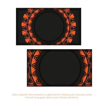 オレンジ色の装飾が施された黒の名刺デザイン。あなたのテキストとビンテージパターンのためのスペースを備えたスタイリッシュな名刺。 Premiumベクター